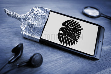 Smartphone wrapped in aluminium foil  German Federal Eagle on smartphone display