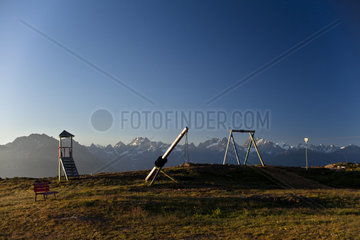 Playground Alps. A childrens playground with the panorama of the Austrian Alps in the backround