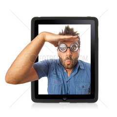 Young boy with a surprised expression in the tablet