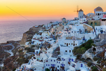 Beautiful Oia village sunset in Santorini island Greece photographed from a high point of view in HDR