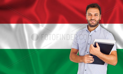 Male student of languages on Hungarian flag