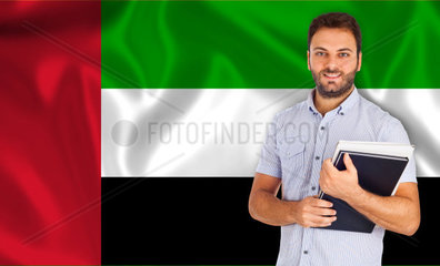 Male student of languages on Arabic flag