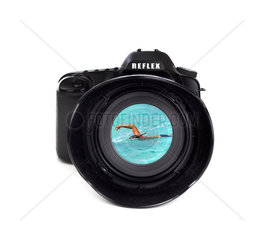 Digital photo camera on white background with tourists swimming