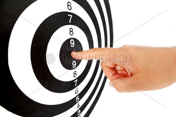 Finger on the center of the target