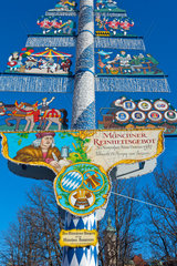Traditional Bavarian maypole   Viktualien market  Munich  Germany