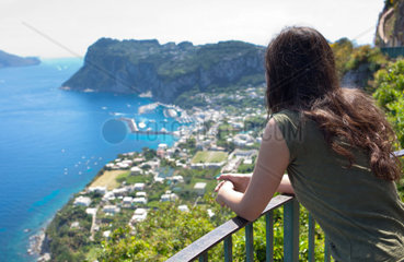 Girl from behind watching the view of Marina Grande in Capri  Italy