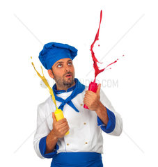 Chef plays with ketchup and mayonnaise on white background