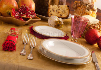 Table decorated for Christmas dinner with warm lighting