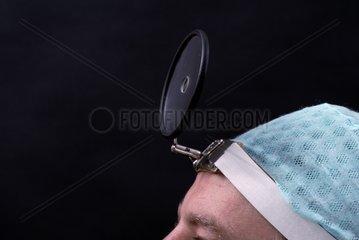 Surgeon Wearing Mirror