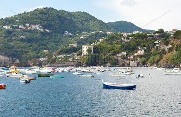 Bay of island of Ischia with boats and mountains