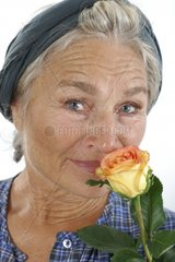 Older Woman with Rose