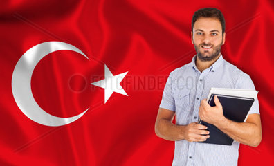 Young smiling student learns the turkish language