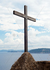 Wooden crucifix in the Aragonese Castle sheer above the sea
