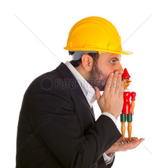 Businessman with Pinocchio on white background