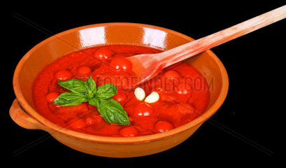 Bowl with tomato sauce and basil