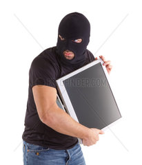 Criminal with balaclava is robbing a monitor on white background