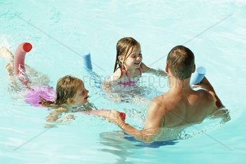 Father with Daughters in Pool