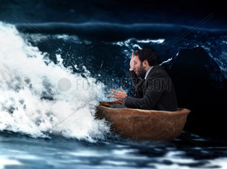 Man in small boat of walnut in a storm
