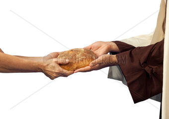 Jesus gives the bread to a beggar on white background