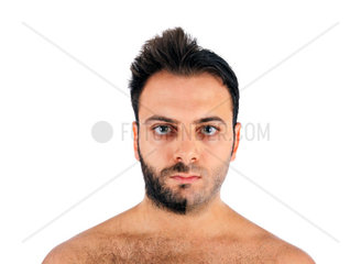 A young man with a beard on half of the face on white background