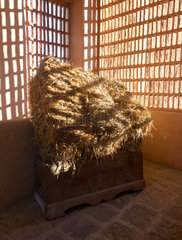 Barn with the sun from outside and straw and hay