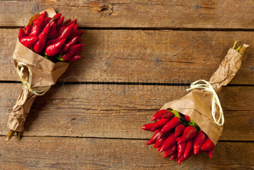 Bunch of fresh small red hot pepper on wooden table
