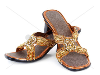 Pair of traditional Indian sandals on white background