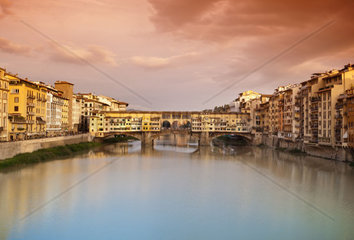 Far view at sunset of Ponte Vecchio in Florence  Italy