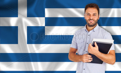 Young smiling student learns greek the language