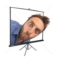Young boy with a surprised expression on projection screen