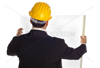 Businessman with construction helmet isolated on white background