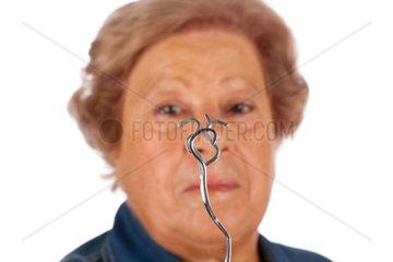 Elderly woman with psychokinetic abilities bend metal fork