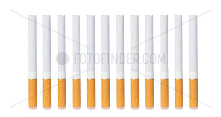 Row of cigarettes isolated on white background