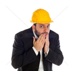 Frightened businessman with construction helmet isolated on white background