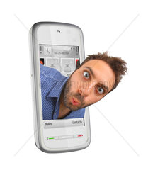 Young boy with a surprised expression in the smartphones