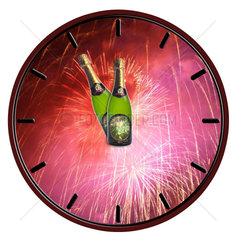 Clock with bottle of champagne waiting for midnight on white background