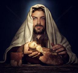 The Last Supper  Jesus breaks the bread