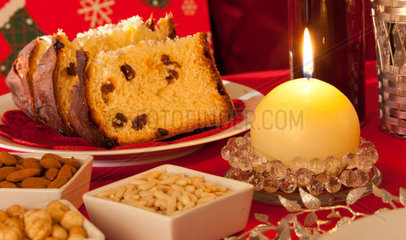Decorated Christmas Dinner Table Setting with food and candeles