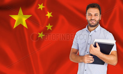 Young smiling student learns the chinese language