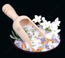 Jasmine flowers and bath salt on black background