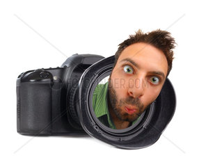 Digital photo camera on white background with wow man