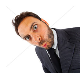 Young businessman with surprise expression on white background