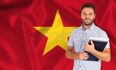 Young smiling student learns the vietnamese language