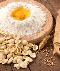 Italian pasta orecchiette homemade on wooden table
