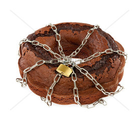 Cake chocolate with chains and padlock  diet concept