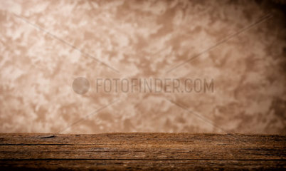 Background with wooden table and beige grunge wall