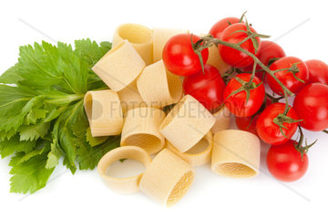 Tricolor pasta with tomato on white background