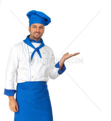 Handsome chef isolated pointing on white background