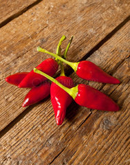 Hot chili peppers Salentini on wooden table