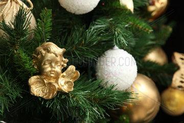 Christmas ball  white and gold on christmas tree